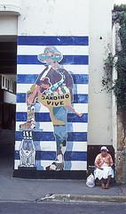 street artist(0.0), poster(0.0), art(1.0), wall(1.0), street art(1.0), road(1.0), mural(1.0), graffiti(1.0), blue(1.0), street(1.0),
