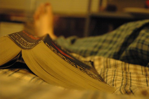 Photograph of a book opened on a bed