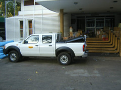 off-roading(0.0), automobile(1.0), automotive exterior(1.0), pickup truck(1.0), vehicle(1.0), truck(1.0), bumper(1.0), nissan navara(1.0), land vehicle(1.0),