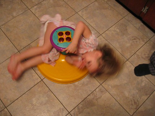 kelsey spinning on the kitchen floor