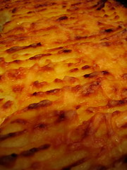 banitsa(0.0), pizza cheese(0.0), pastitsio(1.0), baked goods(1.0), zwiebelkuchen(1.0), food(1.0), dish(1.0), cuisine(1.0), quiche(1.0), cottage pie(1.0),