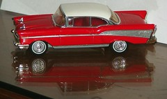 convertible(0.0), model car(1.0), automobile(1.0), automotive exterior(1.0), 1957 chevrolet(1.0), vehicle(1.0), bumper(1.0), chevrolet bel air(1.0), sedan(1.0), vintage car(1.0), land vehicle(1.0), luxury vehicle(1.0), coupã©(1.0),