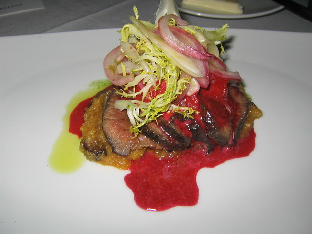 Seared loin of venison, raspberry sorbet, red wine reduction, arugula ...