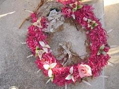 decor(0.0), christmas decoration(0.0), flower arranging(1.0), flower(1.0), floral design(1.0), floristry(1.0), wreath(1.0), pink(1.0), petal(1.0),