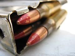 hand(0.0), finger(0.0), lip(0.0), nail(0.0), pink(0.0), cosmetics(0.0), eye(0.0), organ(0.0), brown(1.0), ammunition(1.0),