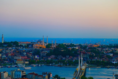 Boats and Suleymaniye Mosque at sunset