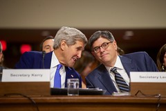 U.S. Secretary of State John Kerry speaks with U.S. Treasury Secretary Jack Lew on July 29, 2015, before they joined U.S. Defense Secretary Ash Carter, Joint Chiefs of Staff Chairman Martin Dempsey, and U.S. Energy Secretary Dr. Ernest Moniz in testifying about the Iranian nuclear deal before the Senate Armed Services Committee in Washington, D.C. [State Department photo/ Public Domain]