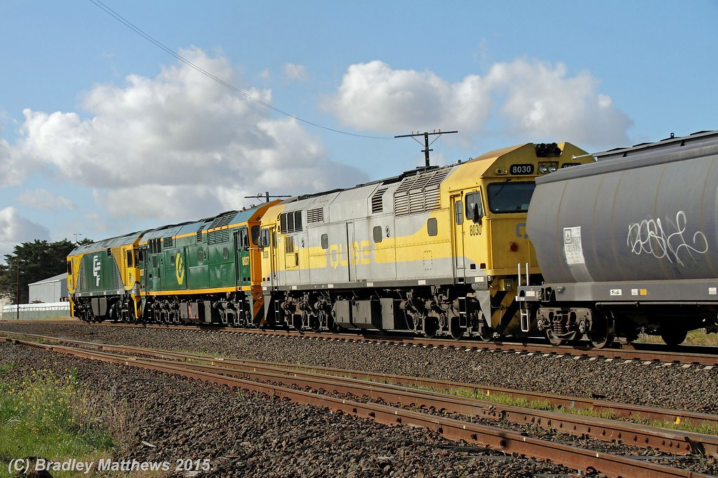 8030 trialing 8037-GL111 with 7737 down empty Qube SG grain at Albion Junction (2/7/2015) by Bradley Matthews