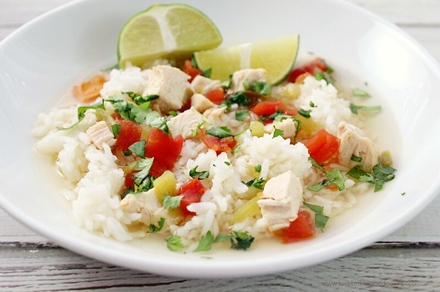 Simple Southwest Chicken & Rice Soup in a white bowl with a lime sliced in two.