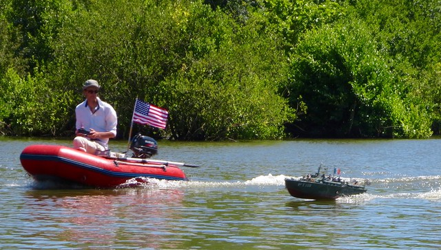 This guy zipped along keeping his RC boat company