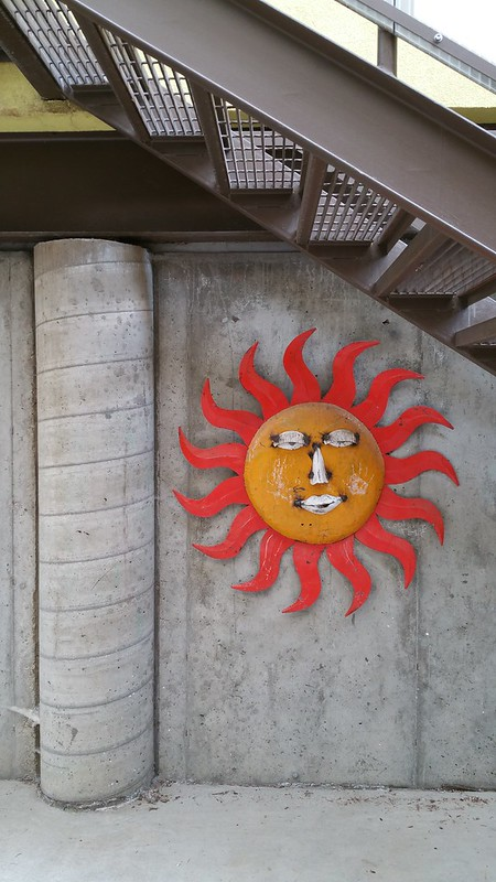 sun on a wall; street art in prospect, longmont