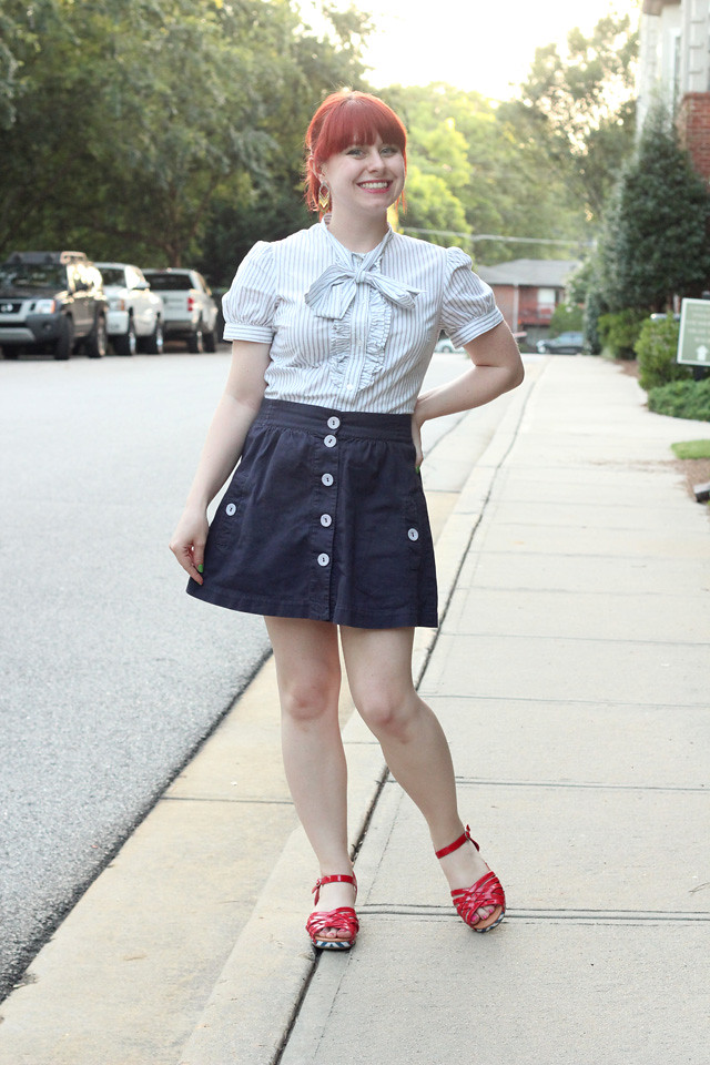 White Pinstriped Bow Neck Blouse, Navy Blue A-line Button Down Skirt, and Red Sandals
