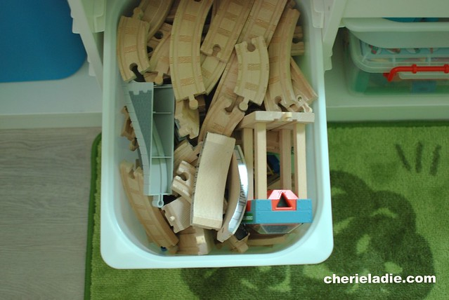 A huge box full of Thomas and friends wooden train tracks.