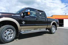 ford f-550(0.0), automobile(1.0), automotive exterior(1.0), ford f-350(1.0), pickup truck(1.0), wheel(1.0), vehicle(1.0), truck(1.0), rim(1.0), ford super duty(1.0), bumper(1.0), ford(1.0), land vehicle(1.0), luxury vehicle(1.0),