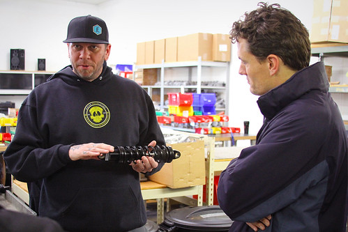Legends Suspensions owner Jesse Jurrens demonstrating a custom manufactured spring coil