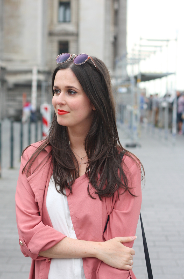 outfit: pink trench coat, orange lipstick