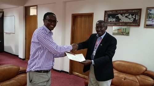 Azage Tegegne exchanges cooperation agreement