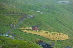 Rain in Velbastaður. The red house úti í Dølum, Faroe Islands
