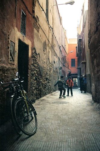 Kids playing football in the old town in marrakech