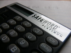 cash(0.0), computer keyboard(0.0), office equipment(1.0), close-up(1.0), calculator(1.0),