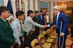 U.S. Secretary of State John Kerry greets students from Pakistan's Army Public School and Degree College in Peshawar, at the U.S. Department of State in Washington, D.C., on July 27, 2015. The students are participating in a State Department International Visitor Leadership Program. [State Department photo/ Public Domain]