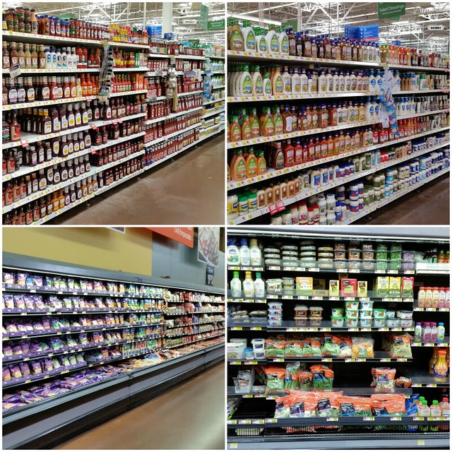 Grocery store isles with products on the shelves.