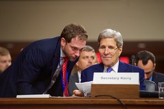 State Department Chief of Staff Jon Finer speaks with U.S. Secretary of State John Kerry on July 29, 2015, before he joined U.S. Defense Secretary Ash Carter, Joint Chiefs of Staff Chairman Martin Dempsey, U.S. Energy Secretary Dr. Ernest Moniz, and U.S. Treasury Secretary Jack Lew in testifying about the Iranian nuclear deal before the Senate Armed Services Committee in Washington, D.C. [State Department photo/ Public Domain]
