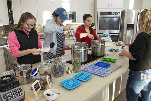 Gganilchit Dena'ina Youth Council members Cheyenne Everett, Nadia Walluk and Raven Willoya-Williams help Council Chairperson Jennifer Showalter Yeoman and other participants at at a bath and body workshop. The event raised funds for the group.