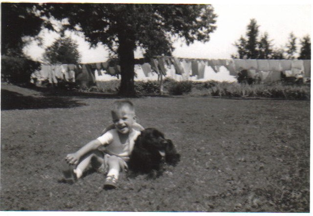 Paul and Skipper with laundry and Grandma's garden in the ba
