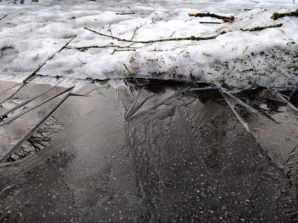 Hard frozen slush and black ice