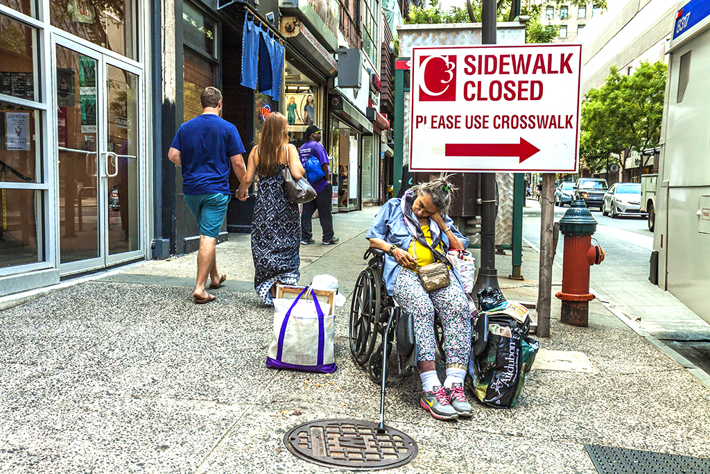 Very old woman in wheelchair at 11th and Chesnut on 7-23-15--Center City