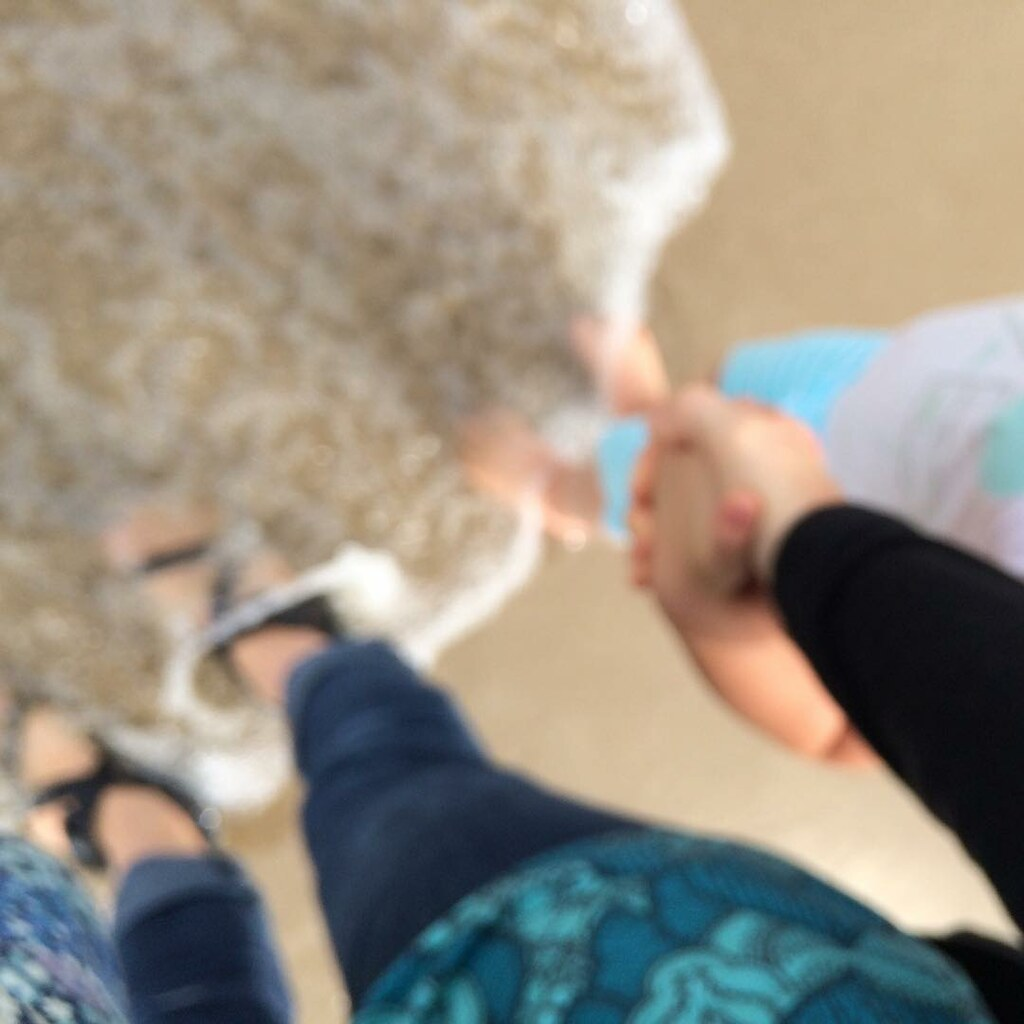 Out-of-focus toe-dipping at the beach.
