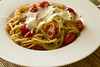 Spaghetti with cherry tomatoes and cashew nuts