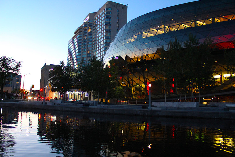 Image of the Rideau Canal and Shaw Centre at sunset during the Haunted Walk Ottawa tour