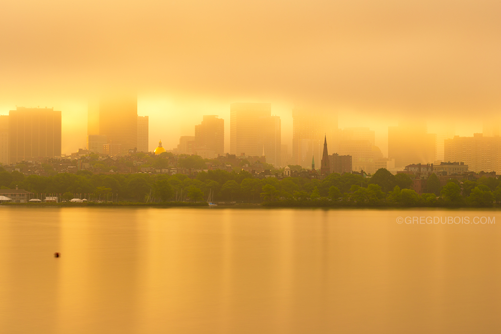 Foggy Golden Sunrise over Boston Skyline, Beacon Hill, Massachusetts State House, and Charles River Reflection - Cambridge MA USA