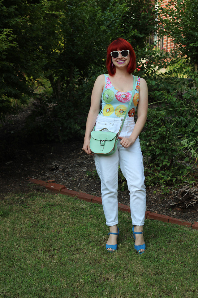 White High Waisted Jeans, Pastel Donut Print Bodysuit, Blue Wedges, and a Mint Green Leather Purse