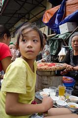 Girl eating Springrolls