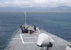 USS John S. McCain (DDG 56) approaches Puerto Princesa, Dec. 24. (U.S. Navy/MC3 James Vazquez)