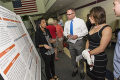 Ashton presenting to faculty & guests