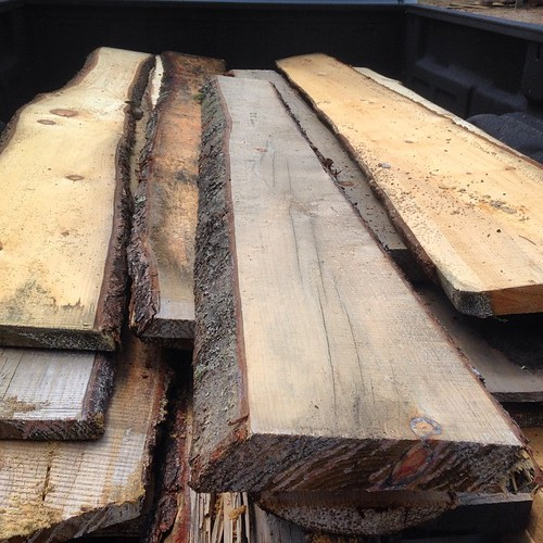 The off-cuts from sawmills are often discarded and wasted. Check to see if you can get free slab wood from your local mill. There are lots of uses.  Part of this is going towards panels for a compost bin. Could also be nice for siding an #adirondack cabin