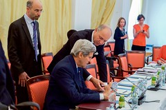 U.S. Secretary of State John Kerry, flanked by U.S. Energy Secretary Dr. Ernest Moniz, chats with French Foreign Minister Laurent Fabius on July 6, 2015, in Vienna, Austria, before the P5+1 member countries met with Iranian officials amid negotiations about the future of their country's nuclear program. [State Department Photo/ Public Domain]