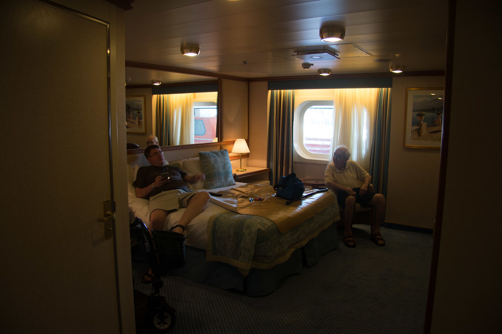 Bed and seating area in cabin