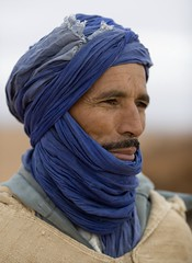 art(0.0), dastar(0.0), wool(0.0), purple(0.0), cap(0.0), textile(1.0), clothing(1.0), head(1.0), scarf(1.0), close-up(1.0), turban(1.0), blue(1.0), portrait(1.0),