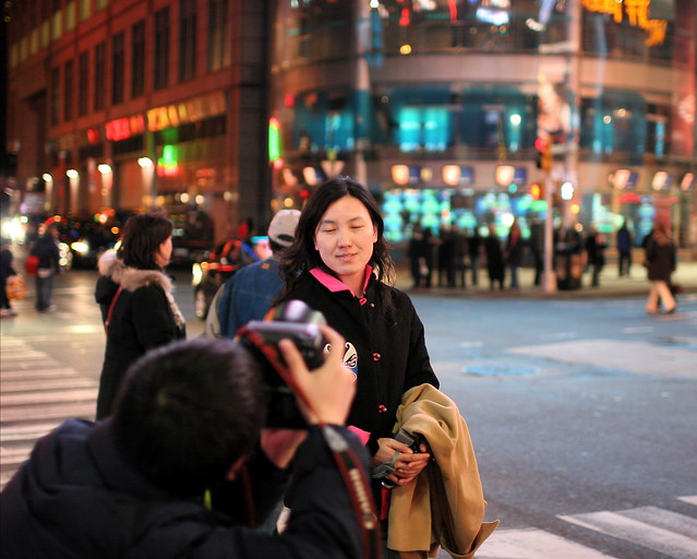 Tourist photographer takes picture of tourist photographer in Times Square