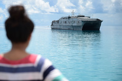 An I-Kiribati girl watches as the joint high-speed vessel USNS Millinocket (JHSV 3) arrives for Pacific Partnership, June 2. Millinocket and the embarked mission team departed Tarawa June 18. (U.S. Navy/MCC Jonathan Kulp)