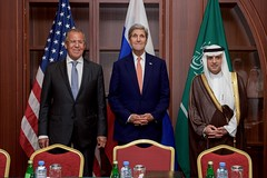 U.S. Secretary of State John Kerry stands with Russian Foreign Minister Sergey Lavrov and Saudi Arabia Foreign Minister Adel bin Ahmed al-Jubeir before a trilateral meeting focused on Syria and other issues following a meeting of the Gulf Cooperation Council in Doha, Qatar, on August 3, 2015. [State Department photo/ Public Domain]