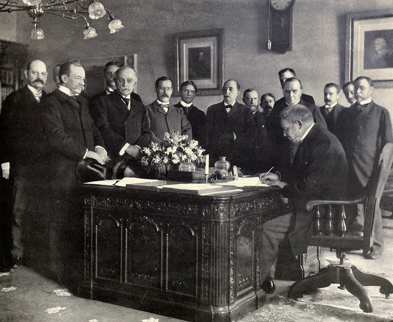 Jules Cambon, the French Ambassador to the United States, signing the memorandum on behalf of Spain