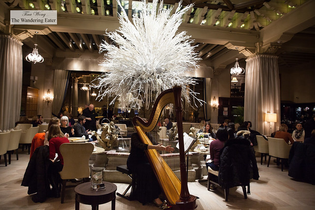 Harpist performing at the front of Palm Court
