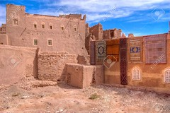 2146866-ouarzazate-old-casbah-with-colorful-carpets-on-the-walls-Stock-Photo