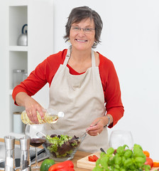 Mature woman preparing food in the kitchen
